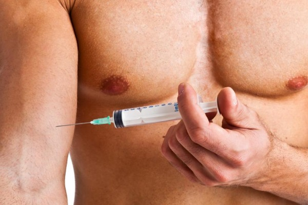 man-injecting-needle-into-arm