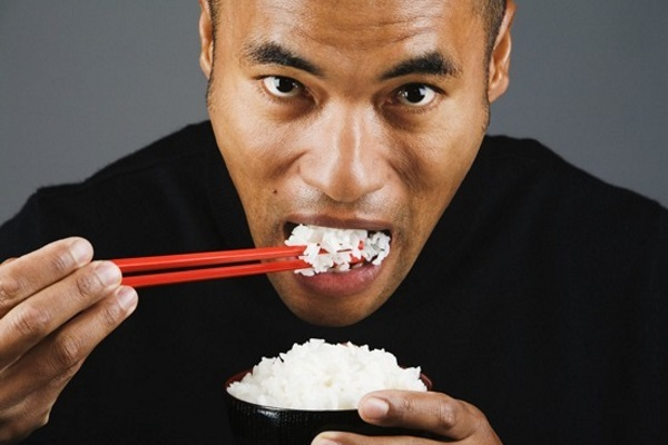 asian-man-eating-rice