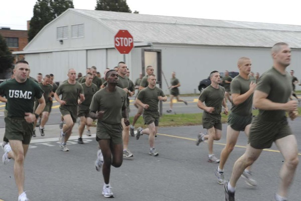 U.S. Marine Corps candidates from Delta Company carry out the Physical Fitness Test (PFT) at the Officer Candiate School (OCS) aboard Marine Corps Base Quantico, Va., Nov. 30, 2009. The PFT is an event in which a candidate's overall strength and endurance is put to the test. (U.S. Marine Corps photo by LCpl Reagan Lodge / Not Released)