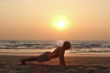 stock-footage-young-man-workout-on-the-beach-training-india-goa