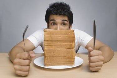 man-with-a-stack-of-bread-slices