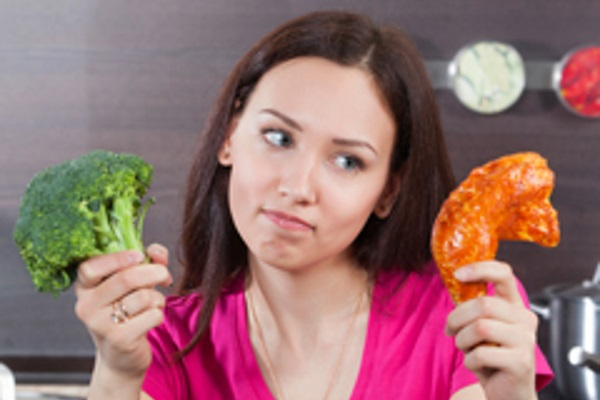 woman-choosing-between-broccoli-and-chicken