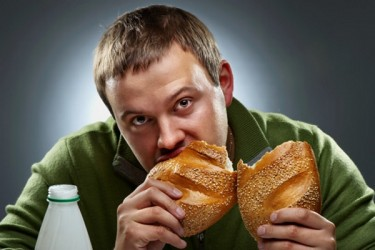 young-man-eating-bread