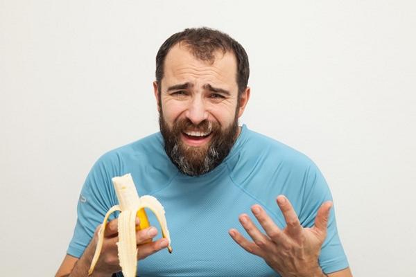 man-unhappy-about-eating-a-banana