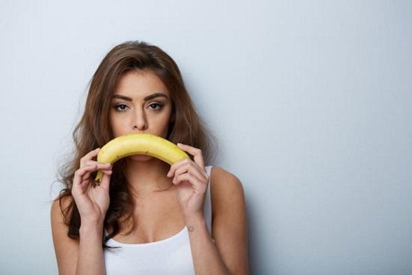 unhappy-girl-with-banana