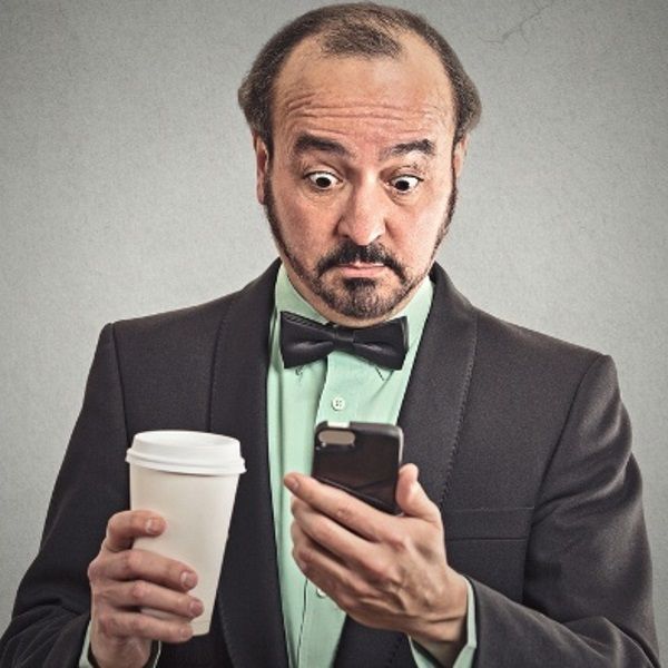 businessman-drinking-coffee-looking-at-phone