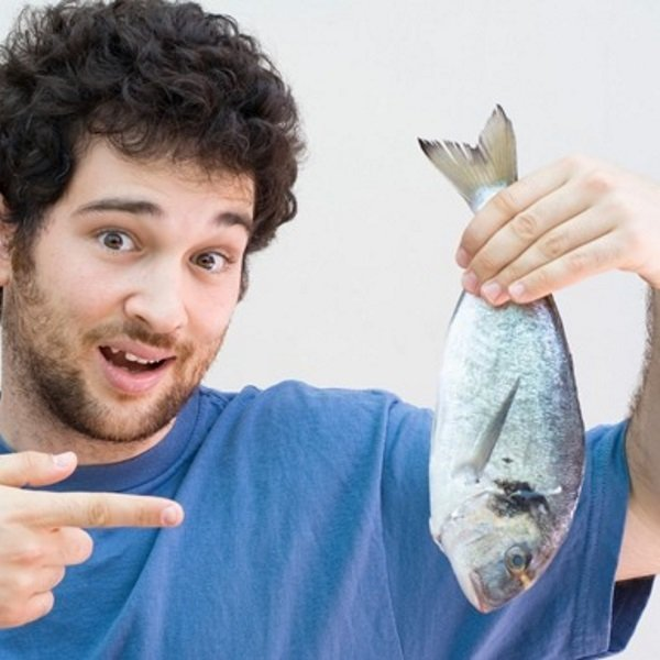 man-holding-a-whole-fish