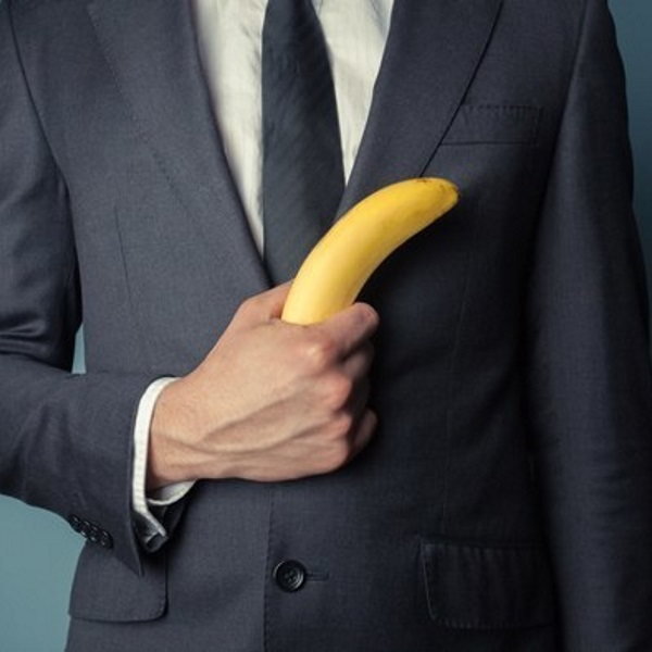 man-in-suit-holding-a-banana