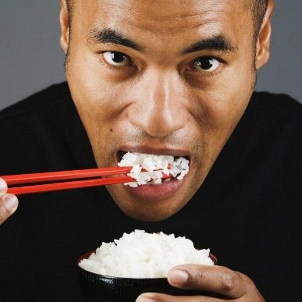asian-man-eating-rice-580px