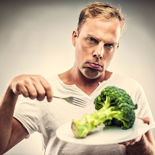 man-with-fork-eating-broccoli