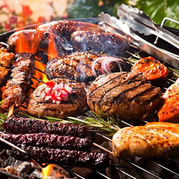 getty_rm_photo_of_assorted_meats_cooking_on_grill