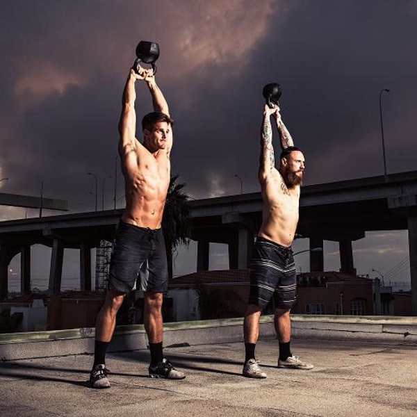 men_working_out_kettlebell_swings_main