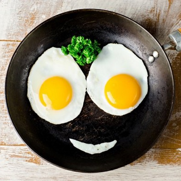 fried-eggs-on-pan-made-into-smiley-face