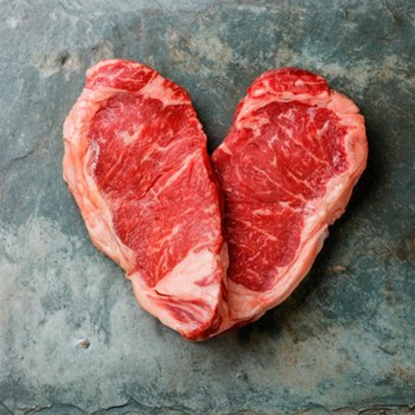 two-pieces-meat-in-heart-shape-on-marble-table