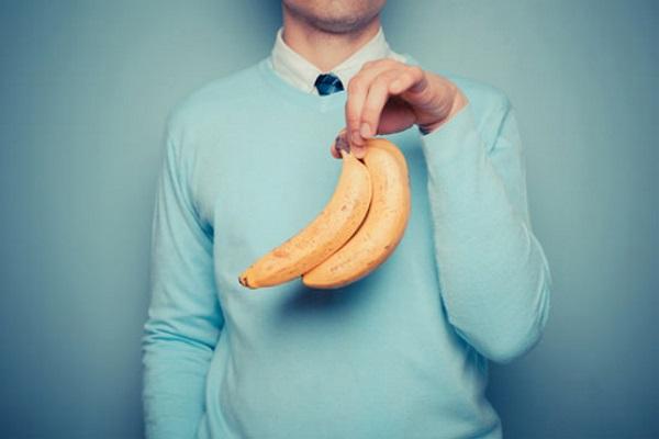 a-man-holding-bananas